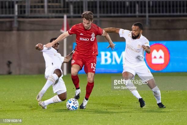 Atlanta United FC Midfielder Mo Adams and Toronto FC Forward Patrick Mullins and Atlanta United FC Defender Anton Walkes battle for the ball during...