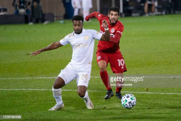 Atlanta United FC Midfielder Mo Adams and Toronto FC Midfielder Alejandro Pozuelo chase the ball during the second half of a Major League Soccer...