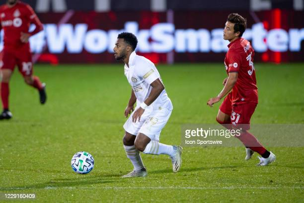 Atlanta United FC Midfielder Mo Adams controls the ball with Toronto FC Midfielder / Forward Tsubasa Endoh in pursuit during the second half of a...