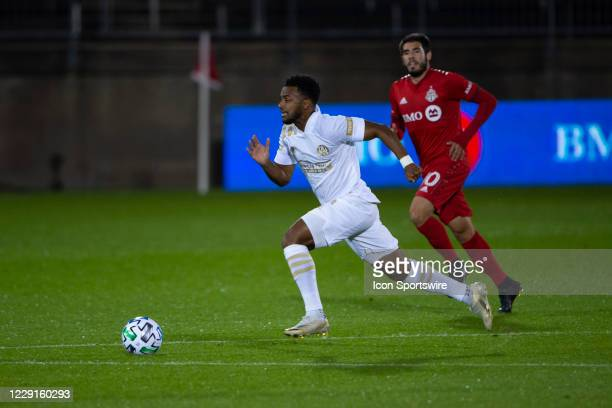 Atlanta United FC Midfielder Mo Adams dribbles the ball up the field during the first half of a Major League Soccer match between the Atlanta United...