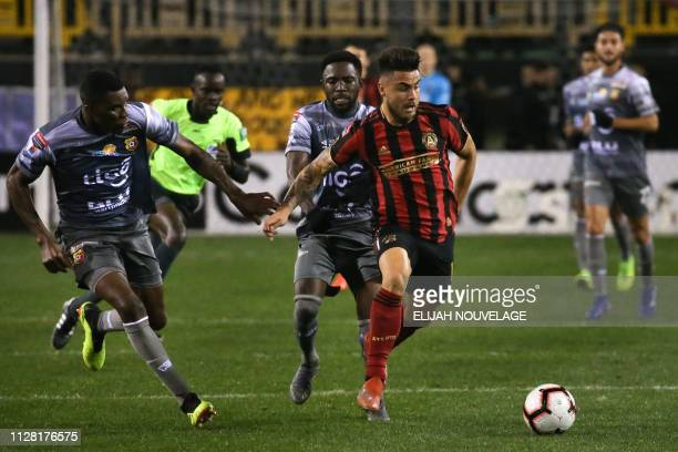 Atlanta United forward Hector Villalba fights for the ball with Herediano's Keysher Fuller during the CONCACAF Champions League playoff football...