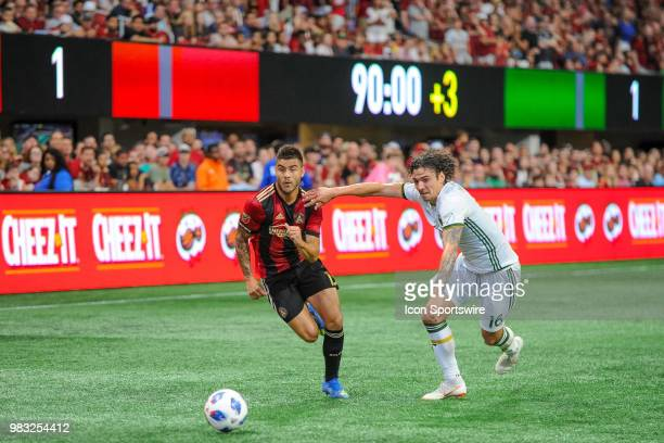Atlanta United forward Hector Villalba goes against Portland Timbers defender Zarek Valentin during a MLS match between the Portland Timbers and...