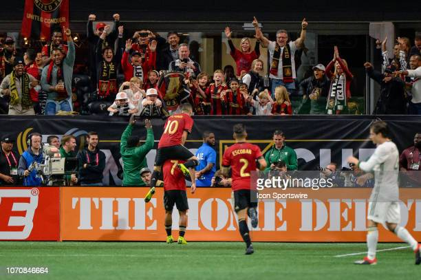 Atlanta United forward Josef Martinez and Atlanta United midfielder Miguel Almiron celebrate a goal during the MLS Cup Finals match between Atlanta...