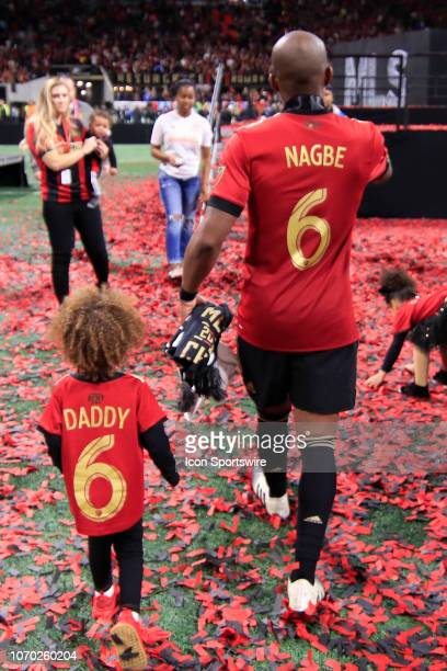 Atlanta United midfielder Darlington Nagbe and his daughter celebrate winning the MLS Cup over the Portland Timbers on December 8 2018 at the...