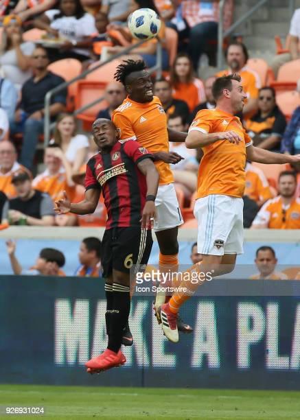 Atlanta United midfielder Darlington Nagbe Houston Dynamo forward Alberth Elis and Houston Dynamo forward Andrew Wenger go up for a header during the...