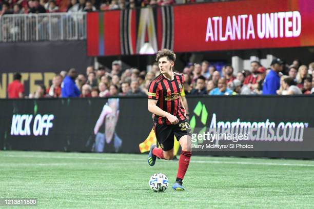Atlanta United midfielder Emerson Hyndman dribbles the ball during the match against FC Cincinnati, which Atlanta won, 2-1, in front of a crowd of...
