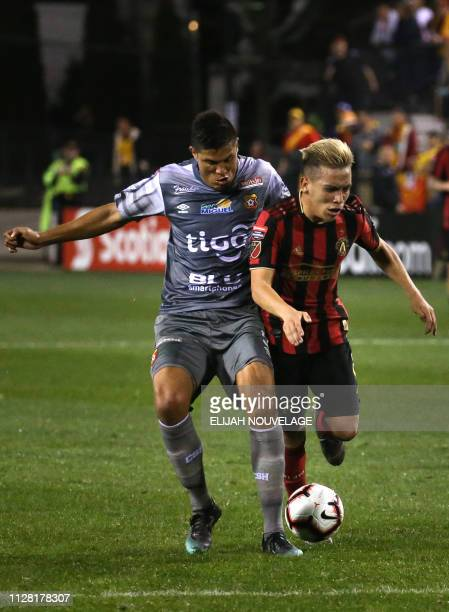 Atlanta United midfielder Ezequiel Barco competes for control of the ball with Herediano midfielder Oscar Esteban Granados in the second half of the...