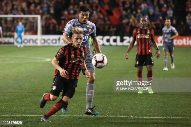 Atlanta United midfielder Ezequiel Barco vies for the ball with Herediano's Oscar Granados in the first half of the CONCACAF Champions League playoff...