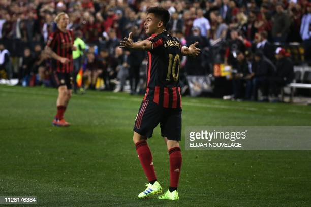 Atlanta United midfielder Gonzalo Martinez gestures to the crowd during the first half of the CONCACAF Champions League playoff football match...