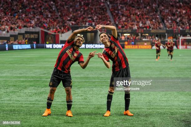 Atlanta United midfielder Miguel Almiron and Atlanta United forward Josef Martinez celebrate a goal during an MLS match between the Orlando City and...