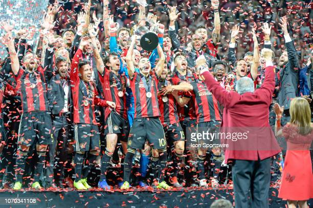 Atlanta United midfielder Miguel Almiron celebrates with the rest of the Atlanta United team after defeating the Portland Timbers 20 in the MLS Cup...