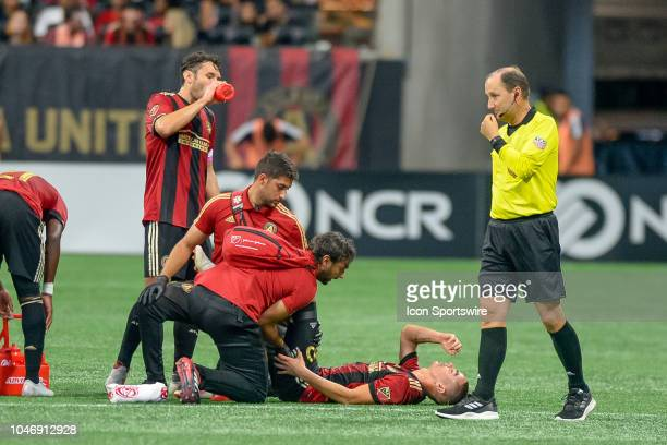 Atlanta United midfielder Miguel Almiron down with an injury during the MLS game between the Atlanta United and the New England Revolution on October...