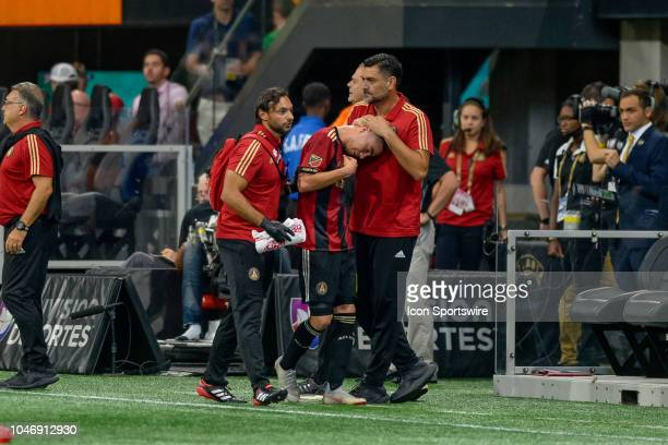 Atlanta United midfielder Miguel Almiron leaves the game with an apparent hamstring injury during the MLS game between the Atlanta United and the New...