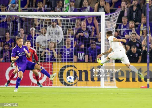 Atlanta United midfielder Miguel Almiron shoots on goal during the MLS soccer match between the Orlando City SC and Atlanta United on August 24th...