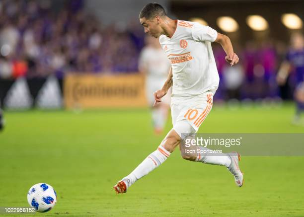Atlanta United midfielder Miguel Almiron shoots the ball during the MLS soccer match between the Orlando City SC and Atlanta United on August 24th...