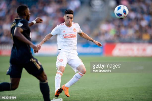 Atlanta United Midfielder Miguel Almiron watches as Union Defender Mark McKenzie attempts to clear the ball in the first half during the game between...