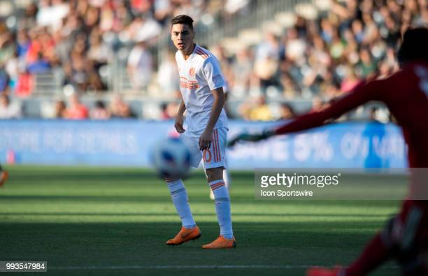 Atlanta United Midfielder Miguel Almiron watches as Union Keeper Andre Blake clears the ball in the first half during the game between Atlanta United...