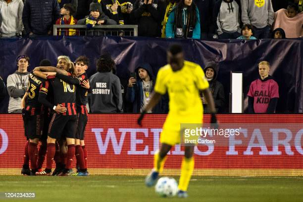 Atlanta United players celebrate a goal scored by Ezequiel Barco during the first half against Nashville SC at Nissan Stadium on February 29, 2020 in...