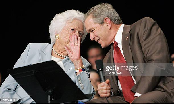 Atlanta, UNITED STATES: US President George W. Bush listens to his mother, Former First Lady Barbara Bush, while speaking about at the Boisfeuillet...