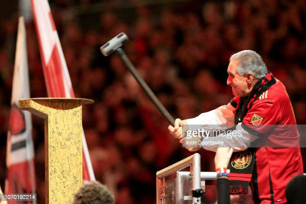 Atlanta United team owner Arthur Blank hammers the Golden Spike prior to the MLS Cup between the Atlanta United FC and the Portland Timbers on...