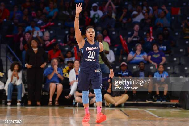 Atlanta's Alex Bentley holds up three fingers after hitting a three pointer in the closing minutes of the WNBA game between Atlanta and Los Angeles...