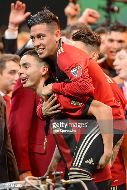 Atlanta's Ezequiel Barco rides on the back of teammate Miguel Almiron during the celebration following the conclusion of the MLS Cup between the...