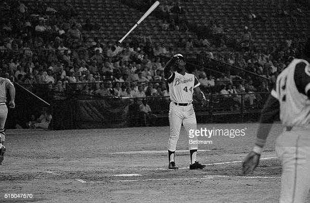 Atlanta's Hank Aaron only seven hours away from breaking Babe Ruth's career home run record of 714 disgustingly throws his bat into the air after...