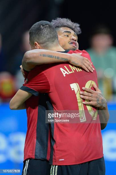 Atlanta's Josef Martinez is congratulated by teammate Miguel Almiron during the MLS Cup between the Portland Timbers and Atlanta United FC on...