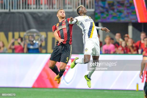 Atlanta's Leandro González Pirez and LA's Gyasi Zardes go up fro a header during a match between Atlanta United and LA Galaxy on September 20 2017 at...