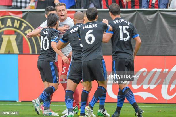 Atlanta's Leandro González Pirez has words with several San Jose players after a hard foul was committed during a match between the San Jose...