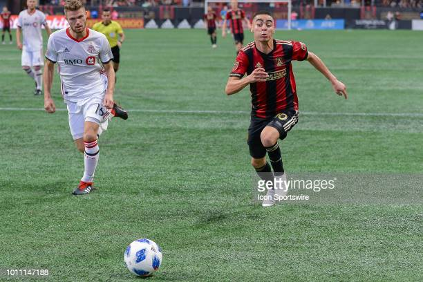 Atlanta's Miguel Almiron charges the ball during the match between Atlanta United and Toronto FC on August 4th 2018 at MercedesBenz Stadium in...