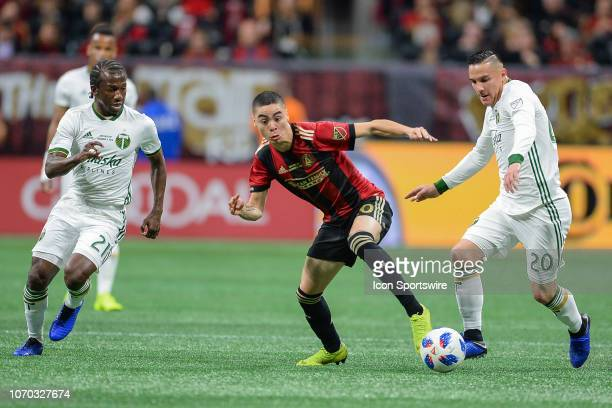 Atlanta's Miguel Almiron fights for possession along with Portland's Diego Chara and David Guzmán during the MLS Cup between the Portland Timbers and...