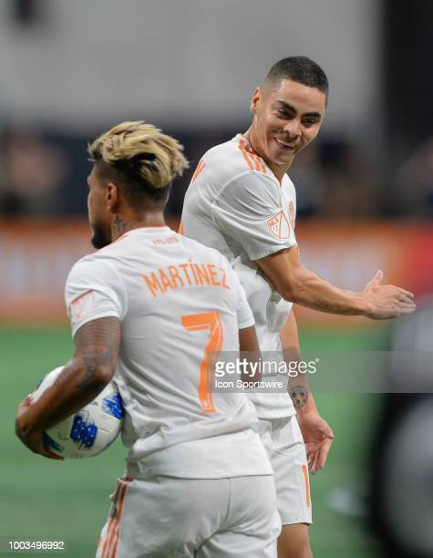 Atlanta's Miguel Almiron gives teammate Josef Martinez a high five after Martinez scored a goal during the match between Atlanta United and DC United...