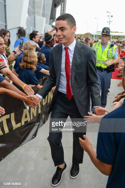 Atlanta's Miguel Almiron greets fans as he enters the stadium prior to the start of the match between Atlanta United and Real Salt Lake on September...