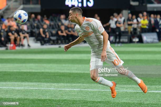 Atlanta's Miguel Almiron heads the ball during the match between Atlanta United and DC United on July 21 2018 at MercedesBenz Stadium in Atlanta GA...