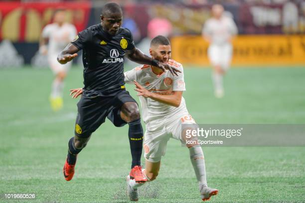 Atlanta's Miguel Almiron is hit in the face by Columbus Crew's Jonathn Mensah during the match between Atlanta United and Columbus Crew on August...