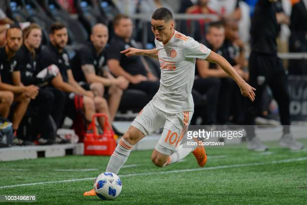 Atlanta's Miguel Almiron moves the ball up the field during the match between Atlanta United and DC United on July 21 2018 at MercedesBenz Stadium in...