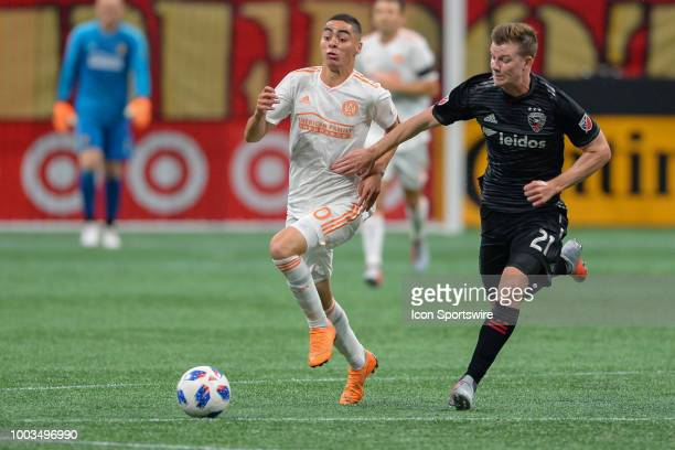 Atlanta's Miguel Almiron moves the ball up the field while defended by DC United's Chris Durkin during the match between Atlanta United and DC United...