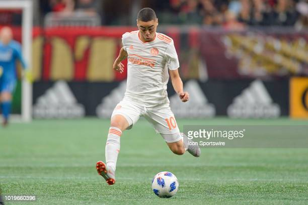 Atlanta's Miguel Almiron passes the ball up the field during the match between Atlanta United and Columbus Crew on August 19th 2018 at MercedesBenz...