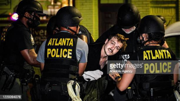 Atlanta's police officers intervene demonstrators during the protest after an Atlanta police officer shot and killed Rayshard Brooks at a Wendy's...
