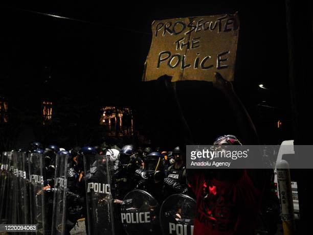 Atlanta's police officers stand guard as demonstrators gather for protest after an Atlanta police officer shot and killed Rayshard Brooks at a...