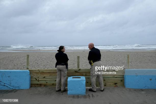 Atlantic Beach Police officers scan the beach ahead of a 10 am curfew before the arrival of Hurricane Florence on September 13 2018 in Atlantic Beach...