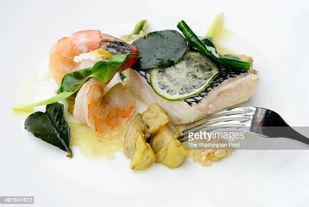 Atlantic Black Sea Bass and Gulf Shrimp Steamed with kaffir lime leaf and artichokes, sprouted barley coulis, ramps at The Grill Room within the...