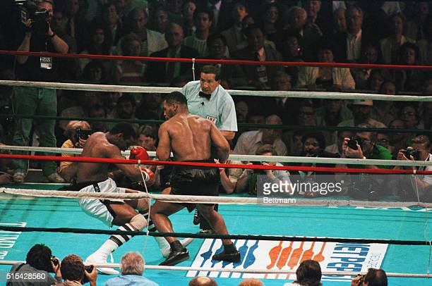 Atlantic City, New Jersey: Mike Tyson knocks out Michael Spinks in first round of heavyweight title bout, June 27.