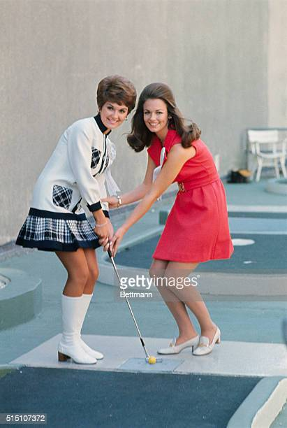 Atlantic City New Jersey Miss Texas Phyllis George and Miss New Mexico Janis Lynn Jones shown with golf club during Miss America pageant at Atlantic...