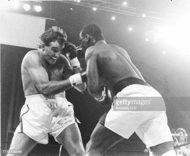 Boxer Gerry Cooney tries to cover up from Michael Spinks' punches in Round 1 of their scheduled 15round heavyweight bout at the Atlantic City...