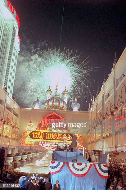 Atlantic City, N.J.: Donald Trump watches from the stand as a huge fireworks display explodes over the towers of his Taj Mahal Casino during opening...