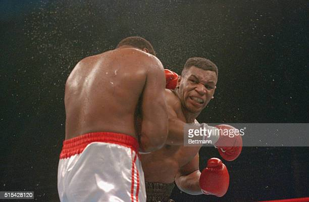 Atlantic City, N.J.: Ferocious faced Mike Tyson lands the knockout punch to the jaw of challenger Larry Holmes during 4th round of the World...