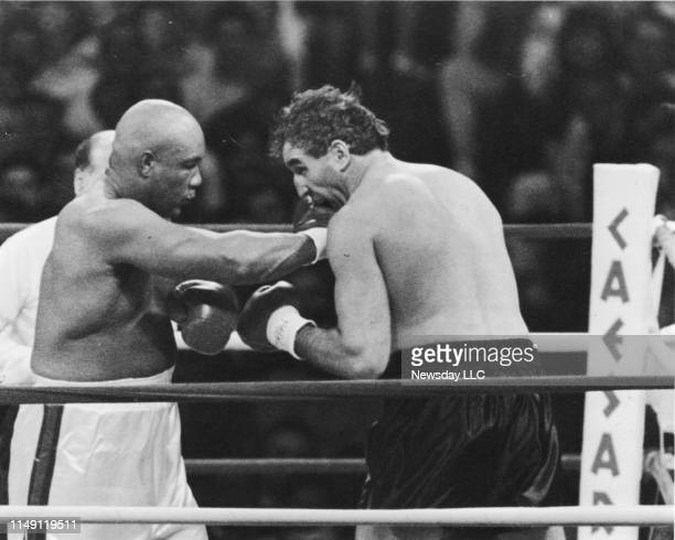 George Foreman delivers a punch to the mouth of Gerry Cooney in the firstround action of a nontitle heavyweight bout at the Atlantic City Convention...