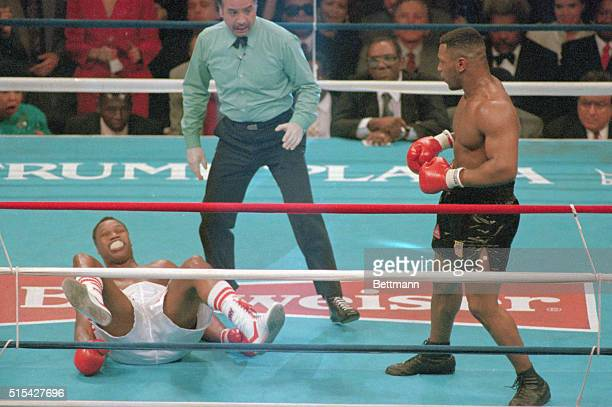 Atlantic City, N.J.: Heavyweight Champion Mike Tyson lands round knockout punch to challenger Larry Holmes who falls to the canvas.